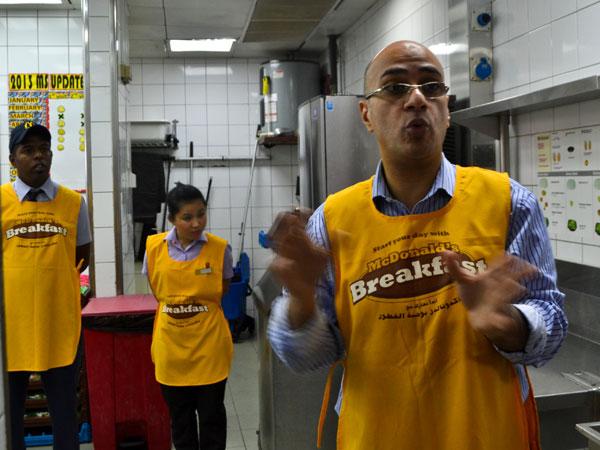Mr. Ali taking us through the McDonalds kitchen tour