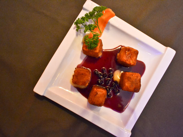 Deep fried brie wedges with blueberry coulees